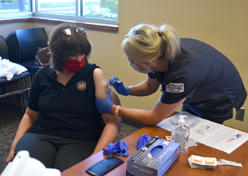 Northeast employees, students line up for flu shots
