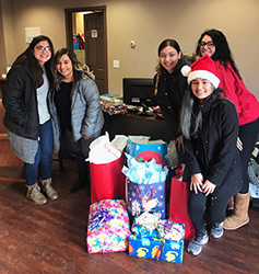 Multicultural Club delivers holiday cheer to Haven House in South Sioux City